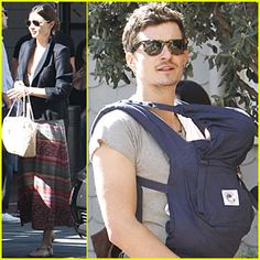 We know, just because someone is a rich and famous Hollywood actor doesn't mean they know anything about baby products... but come on, how cute does Orlando Bloom look toting his son Flynn around in a navy blue Ergo Baby carrier?  Available at Silly Munchkins.