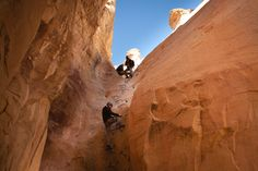 Host Ryan Van Duzer climbs his way up a narrow canyon wall while videographer Scott Johnson films from above. Photograph by Robert Wright