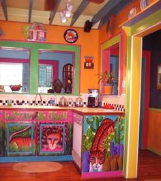 love all these colors! and the cupboard art!