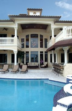 if I ever build... gotta have balcony & outdoor bar area. love this