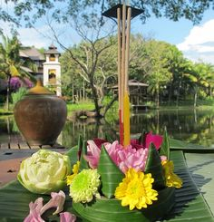 Tradition says that if you'd like to be blessed with riches, add a few coins. To get rid of bad luck, add a small piece of hair or fingernail trimmings. Then float your krathong in the water and watch the candlelight dance.