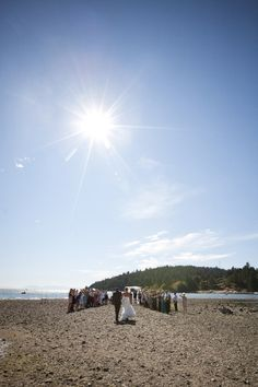 What a gorgeous aisle to walk down! I LOVE beach weddings!  Photo by www.RedivivusPhotography.com