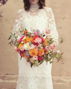 Dahlias, scabiosa, ranunculus, jasmine, roses, and protea
