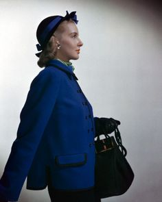 September 1944    Model is wearing the up-and-coming boxy suit in braid-bound royal blue wool tweed, by Tillie Schanzer.