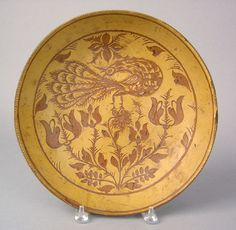 Price:   5,616  Sgraffito decorated redware charger, late 19th c., attributed to Medinger Pottery by William J. McAlister, after a design by Huebner, 12 1/4 dia.    ~♥~