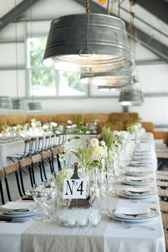 galvanized tubs, suspended above a perfectly neutral table setting with pops of greens.