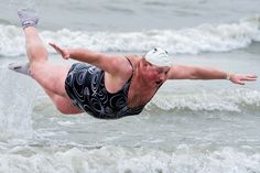 With temperatures around 46 degrees Fahrenheit, a man celebrates the New Year by jumping into the North Sea during the traditional New Year's Dive in Ostend, Belgium on January 5, 2013. (Geert Vanden Wijngaert/Associated Press)