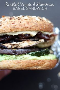 Roasted Veggie and Hummus Bagel Sandwich! This savory breakfast sandwich is my newest obsession. It's hearty and flavorful, yet so easy to make. It's stuffed with creamy hummus and avocado and seasoned roasted veggies and (optional) caramelized onions. With it being vegan too, I'll be eating this daily for the foreseeable future! #vegan #bagelsandwich #breakfast #breakfastsandwich #savoryveganbreakfast #bagel #vegetarian #roastedveggies #hummus #avocado via theconscientiouseater.com