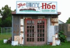 a tiny garden house with personalized branding.....this is actually hilarious!