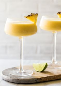 Simple and refreshing Frozen Pineapple Mango Daiquiri full of fresh pineapple for a cocktail hour that will beat the summer heat