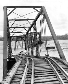 The Burlington Railroad bridge a few miles east of Columbus, Nebraska, collapsed into the Loup River in March 1960. Rain fell on top of heavy snow run-off to cause flooding across eastern Nebraska. THE WORLD-HERALD