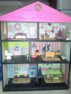 Homemade dollhouse that I made using a bookshelf & scrapbook paper