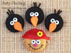 """""""Crow-eos"""" Harvest Cookies ~ These super cute treats were made from Oreos! The crows are regular Oreos with candy eyes and a Circus Peanut cut in the shape of a beak. Tuck a few licorice laces in the cream filling for feathers on top!  The scarecrow is actually an Oreo Cakester with a hat made of fruit roll ups.  I added some mini wheat cereal for the straw and a flower sprinkle. Candy eyes, a sprinkle nose and a mouth drawn in with an edible marker complete the sweet face!"""