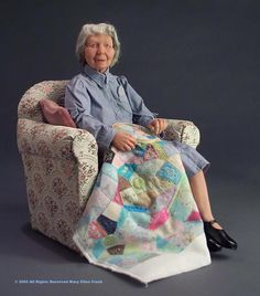 "Mary Jo Hobbs  ""Mary Jo Hobbs, master quilter and her prize winning quilt.  Clay, fabric, fur & leather"