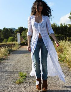 White bohemian dress worn as shirt layered over blue jeans ... Very cool look