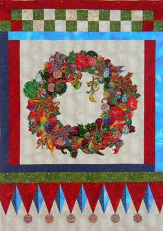 Christmas Wreath by Sherri Grant at Cactus Rose quilts.  A clever Broderie Perse wreath.