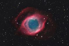 NGC 7293: The Helix Nebula. Only 700 ly from Earth, in the constellation Aquarius, a sun-like star is dying. This image shows details of the Helix's brighter inner region, about three light-years across, but also follows fainter outer halo features that give the nebula a span of well over six light-years. The white dot at the Helix's center is this Planetary Nebula's hot, central star.