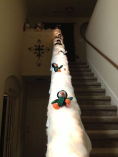 Turn your banister into a penguin slide!  Oh my gosh.... Now I need a house with a banister