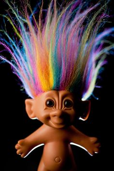 Trolls - came in mini ones as well that fit on the end of a pencil - this rainbow one was my favorite