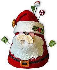 A Santa Claus pincushion - his mustache is a button, how cute is that?