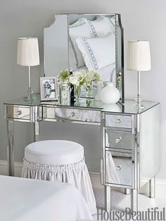 A mirrored dressing table offers another place to put on makeup. 1930s table lamps from Chameleon Fine Lighting.