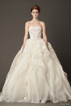 Strapless Vera Wang wedding ball gown with ribbon embroidered bodice and silk organza floating flange skirt accented by lace applique detail at hem