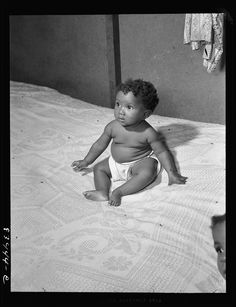 This baby looks so perfect, like a doll!  1942, New Jersey.
