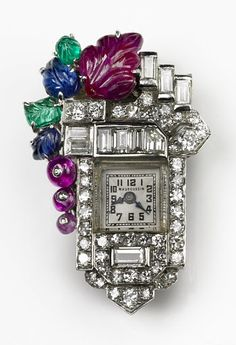 French Art Deco Lapel Watch: rubies, emeralds, sapphires and diamonds, in platinum, circa 1930. #vintage #1930s #jewelry #watches