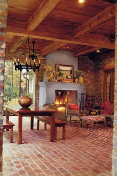 Comfortable Outdoor Porch - Fall's Best Outdoor Spaces - Southernliving. Composed of a brick chimney, mantel, and firebox, this exterior fireplace is covered with stucco as well. This touch not only distinguishes it from the surrounding brick walls, but it also makes a focal point. The hearth is raised for additional seating. Plus, by centering the fireplace between a brick opening and the exterior living room wall, it provided a nook for firewood. Tour this Comfortable Outdoor Porch