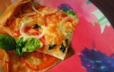 Phyllo Dough Pizza!    160 Calories (Makes one serving)    1. 1 oz Phyllo Dough sheet    2. 1/4 cup fat free kraft Mozzarella cheese    3. Delallo Fat Free All Natural Marinara Sauce    4. 1/4 cup sliced onion    5. 3 tomato slices    6. 1/2 cup spinach leaves    7. 1/2 tablespoon garlic powder    8. basil    Directions:    Spray a pizza pan with fat free cooking spray. Lay out the phyllo carefully and fold it in half.    -Spray phyllo dough layer with cooking spray, sprinkle garlic powder over dough.    -Evenly sprea...