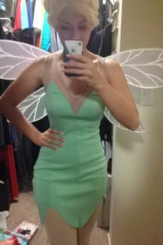 2013 Party Pics - My homemade Tinkerbell costume: bargain dress cut to style, wings from Halloween Express, long blond wig with bangs tied up to form bun, DIY spraypainted pistachio green with white hot-glue puff ball shoes, glitter pouch for fairy dust, opaque George tights from Walmart @Jennifer Bader