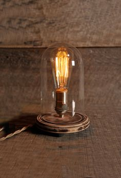 LOVE this! The Original Bell Jar table lamp with cloth covered cord Edison style light bulb. via Etsy.