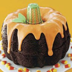 Halloween pumpkin made from two chocolate bundt cakes and orange frosting