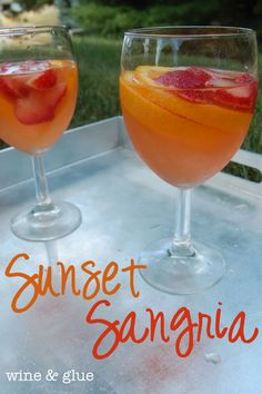 Sunset Sangria.  The perfect summer cocktail.  Strawberries, Oranges, Citrus Rum, Orange Liquor,  Moscoto and   lemon-lime soda