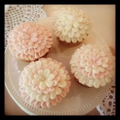 A New and kind of fabulous...Love the looks of these cupcakes the way they are iced.