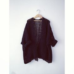 Oversized crochet jacket with 3/4 length sleeves.