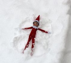 Our first snowfall here in Minnesota, and what I do find? Cuddles out making snow angels.... No fake snow for him!