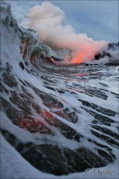 World's first shot of a wave over lava. Photographer braved 110 degree F waters and magma to get the shot.