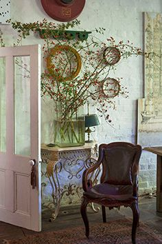 outdoor porch, galleri, pink door, ana rosa, bricks, nook, exposed brick, leather chairs, branches