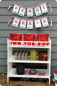 Though this theme is a back to school party dessert/drink station it could be any theme for a kid. That is a changing table and buckets hold ice with ice cream tubs in it and bottles are frappucino bottles from Starbucks...cute and creative..
