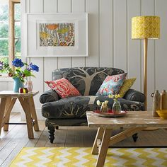 Panelled country living room with navy sofa | Living room decorating | Country Homes and Interiors | Housetohome.co.uk