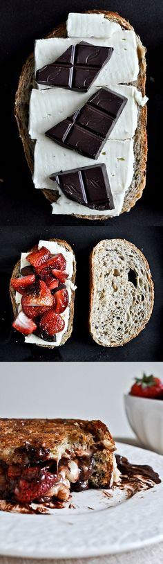 Roasted strawberries between two slices of fresh bread with some brie and dark chocolate.