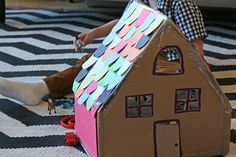 Cardboard doll house. P would love to make one.