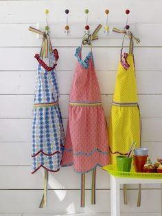 three beautiful aprons.