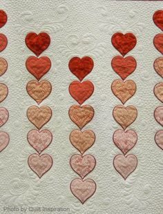 close up, A Cascade of Hearts by Joelyn Fevurly (Leavenworth, Kansas), quilted by Theresa Ward,  shown at AQS Phoenix - 2014.  Accuquilt award. Photo by Quilt Inspiration