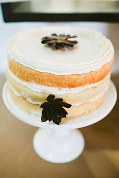 naked wedding cake with iced top layer // photo by Julie Harmsen // http://ruffledblog.com/seattle-summer-wedding