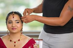 1 indian bride getting ready red jewelry via IndianWeddingSite.com