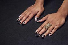 A nude and black manicure.