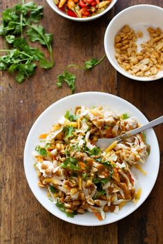This Thai Chicken Salad is dressed up with peanuts, cilantro, carrots and papaya.