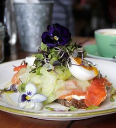 Sydney's The Grounds features a garden of vegetables, herbs and olive trees and dishes like the house-cured ocean trout show off its ingredients grown on site.